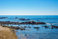 Tropical sea ocean rocky shore with stones and sunny day Royalty Free Stock Photos