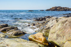 Tropical sea ocean rocky shore with stones and sunny day Royalty Free Stock Images
