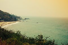 Tropical sea view with trees and rocks in the background. Stock Photography