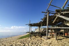 tropical sea view under wooden hut at sunny day. sandy beach and blue sky. Stock Images