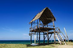 Tropical sea view under wooden hut at sunny day. sandy beach and blue sky. Stock Photos