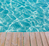 Tropical sea water texture from a wooden pier Royalty Free Stock Image