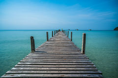 Tropical sea and wooden pier, holiday background Royalty Free Stock Images