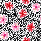 Tropical seamless background with hibiscus flowers and leopard pattern. Exotic animal and floral vector illustration. Tropical seamless background with hibiscus Royalty Free Illustration
