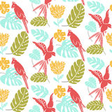 Tropical seamless background with parrots and palm leaves. Summer texture for fabric design. Trendy yellow, pink, green Stock Photography