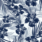 Tropical seamless monochrome blue indigo camouflage background with leaves and flowers Royalty Free Stock Photo