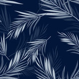 Tropical seamless monochrome blue indigo camouflage background with leaves and flowers Royalty Free Stock Images