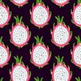 Tropical seamless pattern with dragon fruit  on the black background. Stock Image