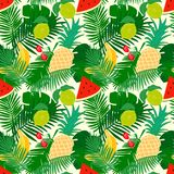 Tropical seamless pattern with jungle leaves and fruit, trendy floral background. Stock Image