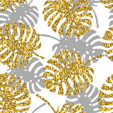 Tropical seamless pattern with monstera leaves and golden glitter texture. Vector illustration Stock Image