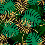 Tropical seamless pattern with monstera leaves and golden glitter texture. Stock Photos