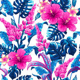 Tropical seamless pattern with palm leaves. Tropical leaves and flowers background. Seamless vector pattern with jungle leaves and exotic flowers in trendy Royalty Free Stock Photo