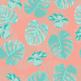 Tropical seamless pattern with palm monstera leaves and flowers Royalty Free Stock Images