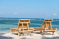 Tropical seascape with bamboo beach beds Stock Photography