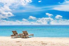 Tropical seascape with bamboo beach beds Stock Photos