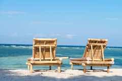 Tropical seascape with bamboo beach beds royalty free stock photo