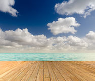 Tropical seascape with empty wooden jetty Royalty Free Stock Image