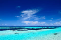 Tropical seascape in Maldives. Tropical seascape of the fresh turquoise sea water, deep blue sky and white clouds in Maldives stock photography