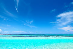 Tropical seascape in Maldives. Tropical seascape of the fresh turquoise sea water, deep blue sky and white clouds in Maldives stock photo
