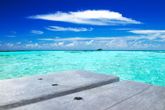 Tropical seascape in Maldives. Tropical seascape of the fresh turquoise sea water, deep blue sky and white clouds in Maldives stock photos