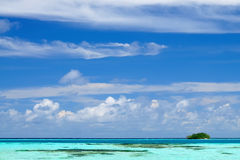 Tropical seascape in Maldives. Tropical seascape of the fresh turquoise sea water, deep blue sky and white clouds in Maldives stock images