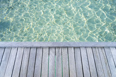Tropical seascape with wooden platform on the turquoise ocean. Royalty Free Stock Images