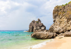Tropical seaside scene with mountain. Aqua blue sea water and white sand beach. Stock Images