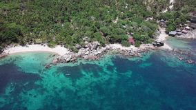 Tropical Secluded Island Koh Tao with Crystal Clear Lagoon Water and White Sandy Beach in Thailand. Aerial Top View. Shot with a DJI Mavic fps 29,97 4k stock video footage