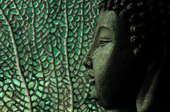 Tropical and serene buddha with oceanic background in green Stock Image