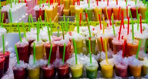 Tropical Set fresh fruits juice straws. Tropical Set fresh fruits refreshing drinks cold lemonade juice smoothies in the glasses cups, jars with straws good stock photo