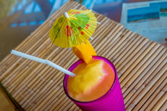 Tropical shake, refreshment drink in glass on tropical. Tropical shake, refreshment drink in decorated galss on tropical background stock photography