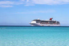 Tropical ship. Cruise ship in the clear blue Caribbean ocean with boat tenders picking up passengers going to shore Stock Images