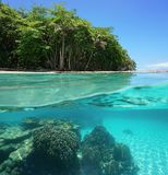 Tropical shore above and below sea surface Stock Images