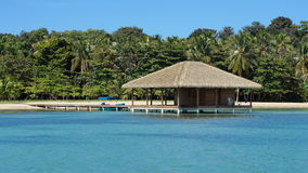 Tropical shore platform thatched roof over the sea Stock Image