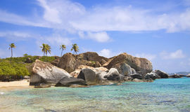 Tropical shoreline. Of the virgin islands, covered with large boulders Stock Image