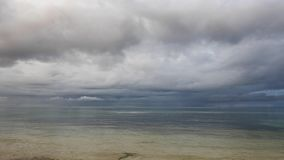 Tropical Siquijor Beach After the Storm. A darker, overcast clip from Siquijor Island shores, showing the calm ocean after a tropical storm stock video footage