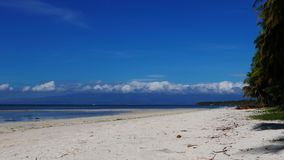Tropical Siquijor beach time lapse. A bright clip from Siquijor Island white sand beaches. Low altitude clouds can be seen moving over the ocean. Presented as stock video