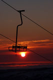 Tropical Ski Resort Chair Lift. Early morning tropical sunrise view through a chair lift during the ski season Stock Photography