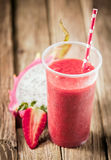 Tropical smoothie with strawberriyand dragon fruit Royalty Free Stock Photo