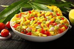 Tropical spicy mango friut salsa Stock Image