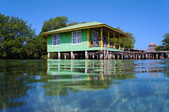 Tropical stilt house over the sea Royalty Free Stock Photos