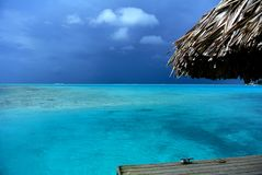 Tropical storm brewing over ocean. Dark clouds form over the open ocean in bora bora French Polynesia stock images