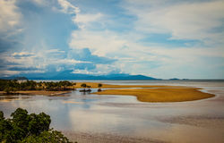 Tropical storm. A tropical storm builds over the mountains at low tide Royalty Free Stock Photos