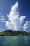 Tropical Storm Clowds Brewing. A Tropical Storm brewing over an island with huge clouds ready to poor rain Stock Image
