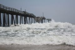 Tropical Storm Collides with the Frisco Pier Stock Photography