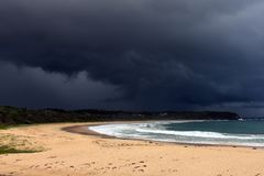Tropical storm over the beach. Huge tropical thunderstorm over Blackhead Beach, New South Wales, Australia Stock Images