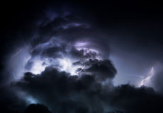 Tropical Lightning Storm Clouds. Summer monsoon storm clouds with lightning Royalty Free Stock Images