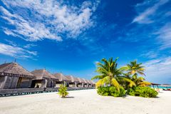 Tropical straw cabins on the tropical beach stock images