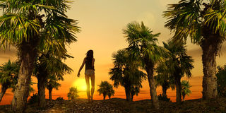 Tropical Stroll - 01. A young woman takes a sunset stroll down to the beach Royalty Free Stock Photography