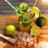 Tropical summer drink. Cold tropical summer drink on a wooden counter royalty free stock photo